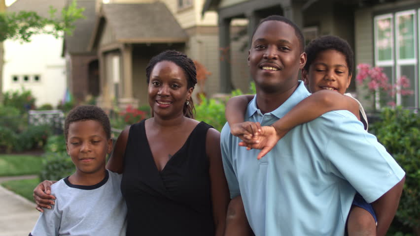 Adorable  African American family portrait. Medium shot
