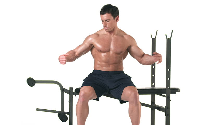 Heavy Bench Press Videos Part - 25: Medium Shot Of A Muscular Bodybuilder Lifting His Arms And Flexing While  Sitting On A Bench