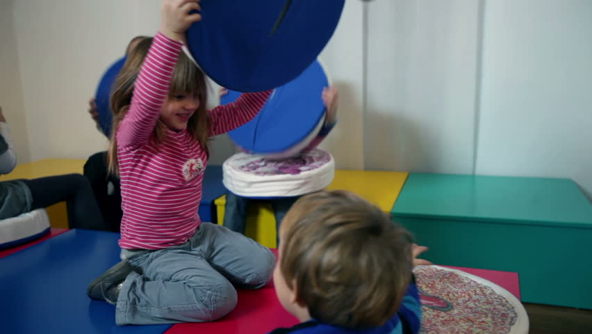 Kids playing in kindergarten with pillows   Shutterstock HD Video #4625201