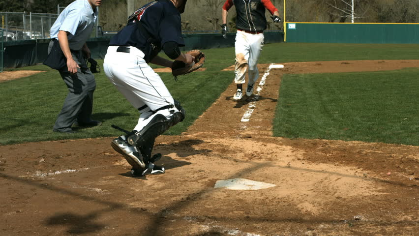 Baseball players collide at home plate