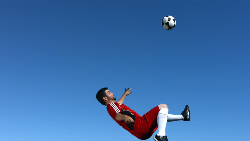 Soccer player jumps in the sky, slow motion #4654451
