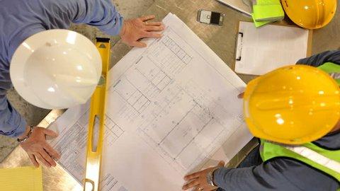 Construction Industry, contractors look over blueprints