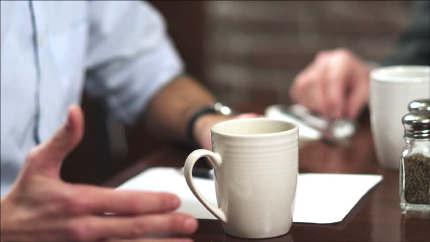 A group of people using tablet computers meet at a coffee shop. Close up shot. | Shutterstock HD Video #4659239