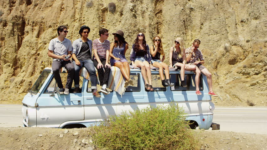 Group of young people on road trip