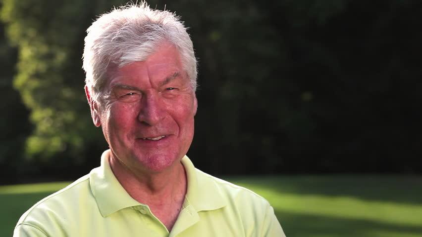 Senior man looks at camera and smiles. Medium shot. | Shutterstock HD Video #4666001