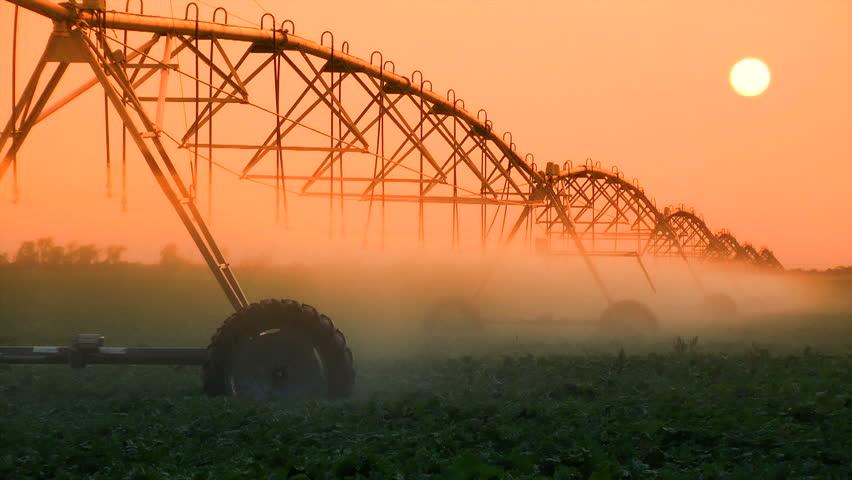 Industrial irrigator spraying water on a field of crops, Nebraska