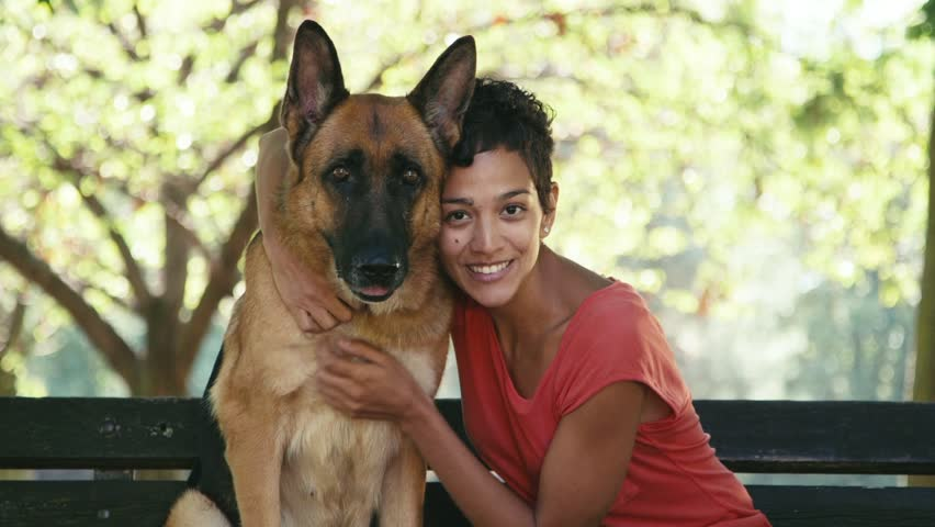 15of15 Young people and pet, portrait of happy hispanic girl at work as dog sitter with alsatian dog in park, smiling and looking at camera