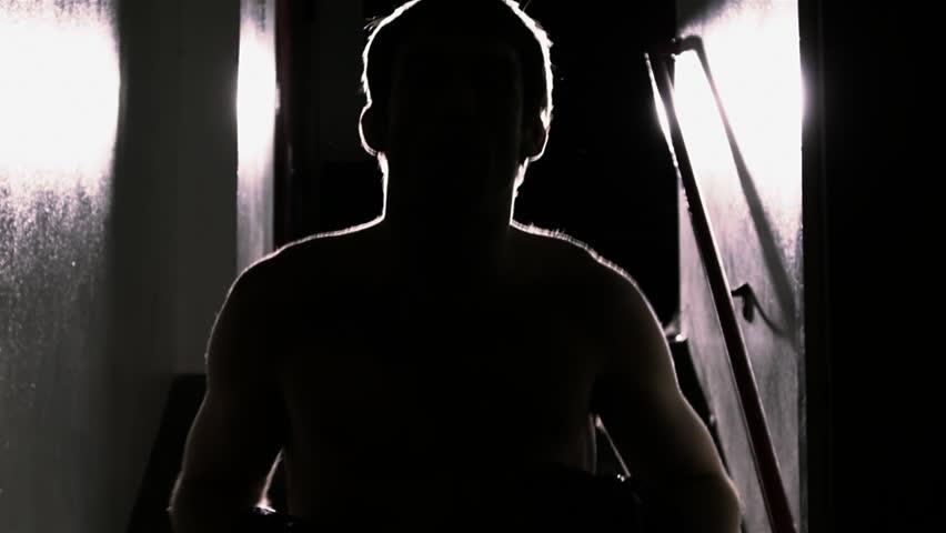 Mixed martial arts athlete mentally psychs himself up. Medium shot. | Shutterstock HD Video #4689401