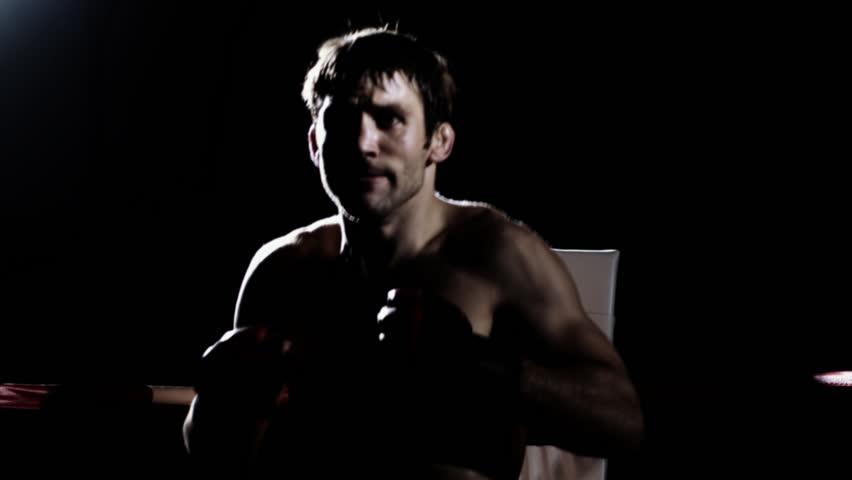 Athlete prepares himself for a mixed martial arts fight. Medium shot.