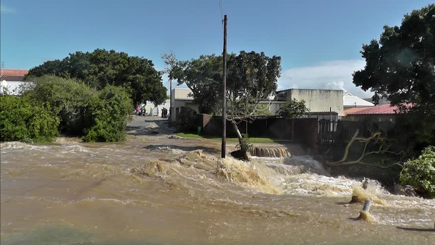 A flood passing through houses in the town of Bushman's River, in the Eastern Cape, South Africa.