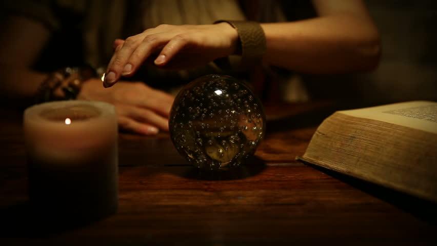 female fortune teller looks in the future
