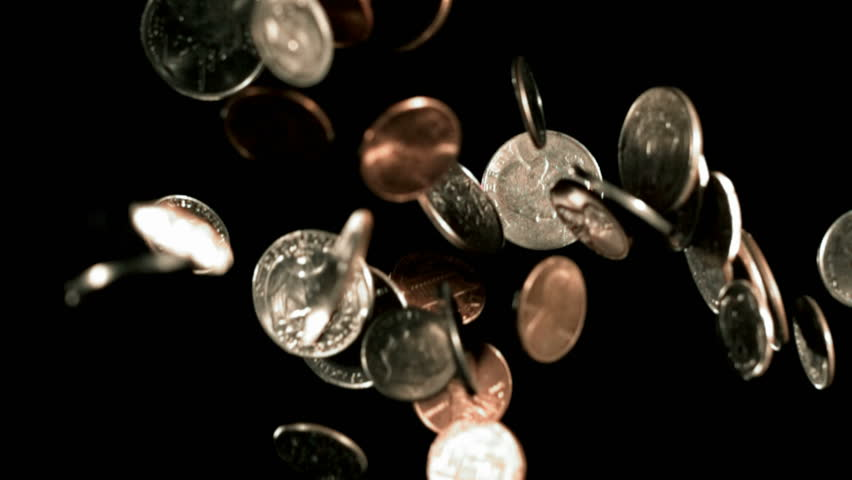 Coins falling in slow motion