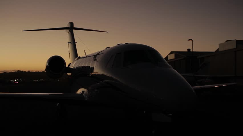 Steadicam shot of a Cessna Citation IV jet airplane grounded at dusk. Shot on a Canon 5D MK II with a Zeis 50mm f1.4 prime lens.