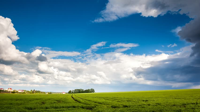 Time lapse clip. HD video (High Definition). Field with overcast sky. Dark ominous clouds. Ukraine, Europe. Beauty world.