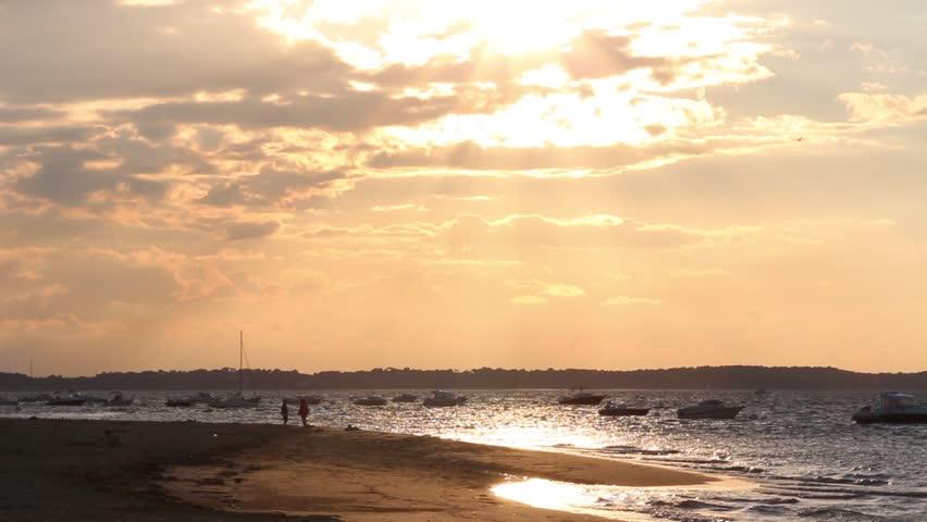 Sunbeam cloudy sunset beach - Full HD Beautiful sunset with sunbeams through the cludy orange sky - 1080p
