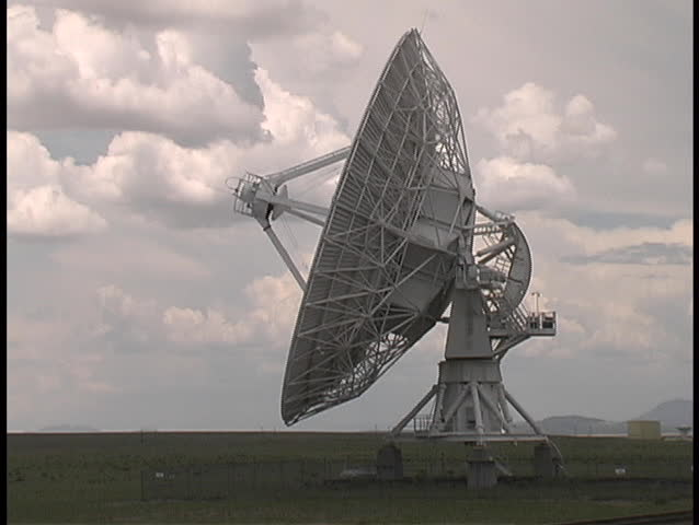 A radio telescope dish rotates towards its target in the sky - from the Very Large Array in western New Mexico