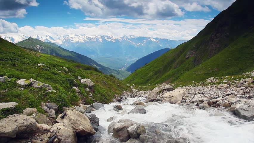 River in mountain valley at the foot of  Mt. Ushba. Upper Svaneti, Georgia, Europe. Caucasus mountains. Beauty world. HD video clip (High Definition)