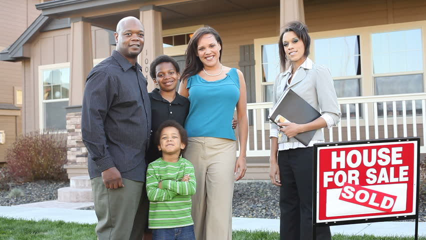 Family buying new home with realtor | Shutterstock HD Video #4742663