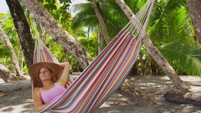woman sitting in hammock relaxing costa rica   hd stock footage clip mother swings young girl in hammock at beach costa rica  shot on      rh   shutterstock