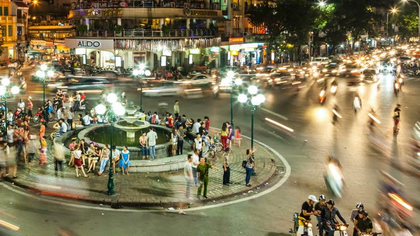 HANOI - SEPTEMBER 18: Timelapse view of crazy traffic in Hanoi Hoan Kiem district (old quarter) on September 18 2013 in Hanoi, Vietnam.