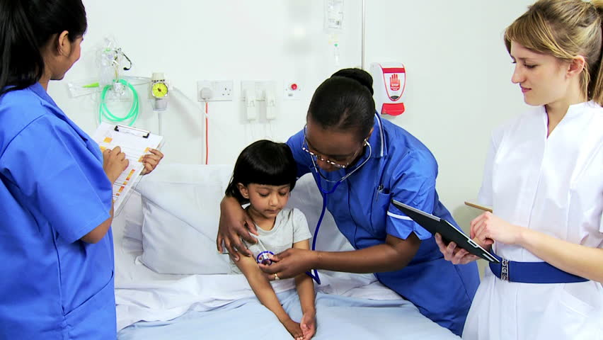 Portrait Asian Indian Pediatric Nurse Smiling To Camera -5420