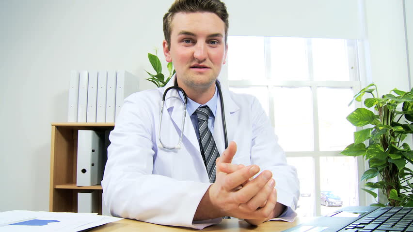Caucasian Male Doctor Video Conference Call Discussing -8771