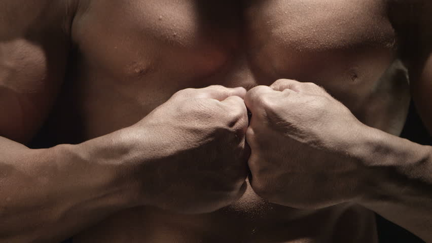 Muscular man hits the hands #4796849