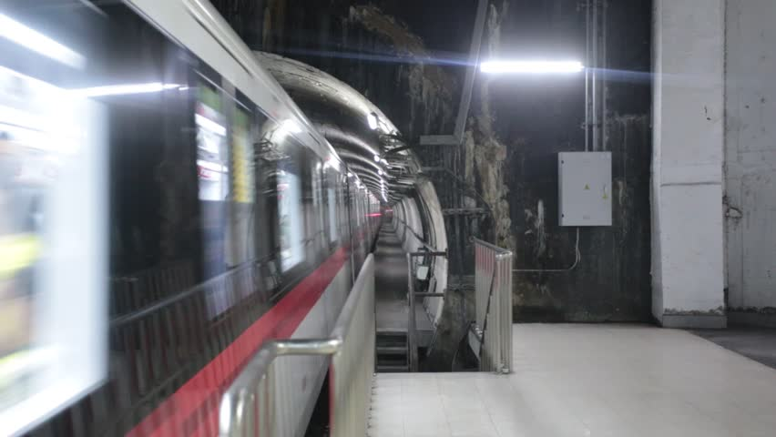 Metro train arriving and departing in underground station on Sep 29, 2013, in