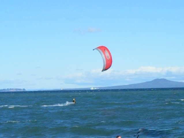 A clip of a kite surfer on a windy day