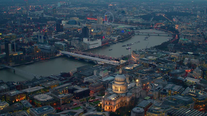 Aerial view along the River Thames in Central London, UK. Showing St Paul's Cathedral, The Millennium Wheel (London Eye) & Waterloo district.