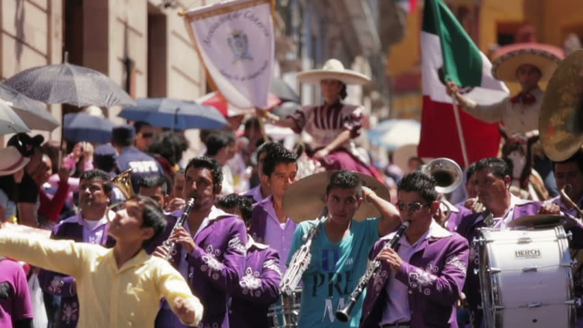 GUANAJUATO, MEXICO - 28 SEPTEMBER 2013: Folkloric band playing instruments during street parade DESFILE DE GUANAJUATO 2013