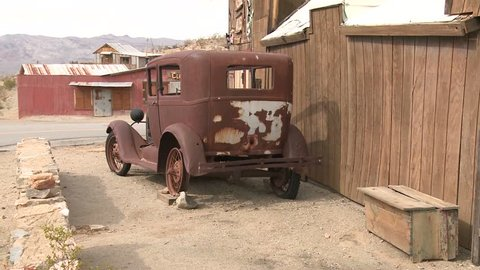 An old car sits in the ghost town of Garlock, California.