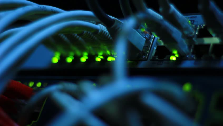 Router routing data over Ethernet in the company data center. | Shutterstock HD Video #4850738