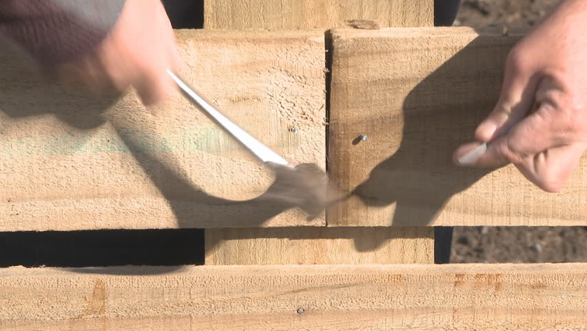 Using a power saw to cut timber