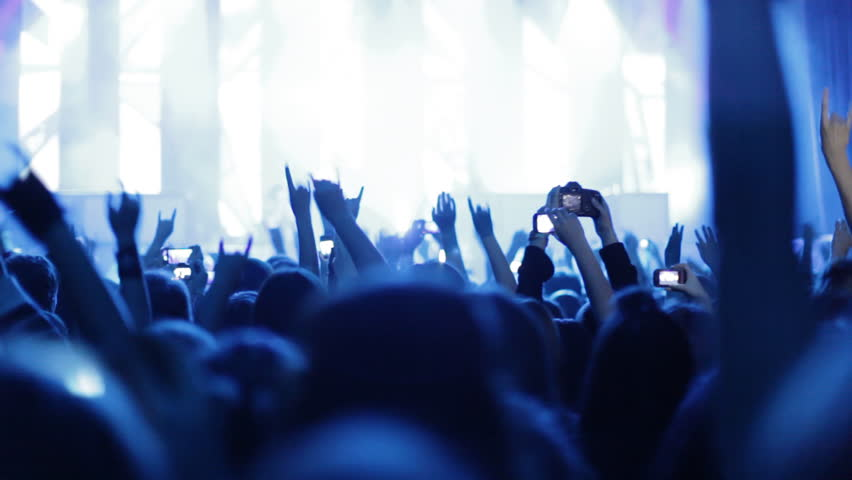People at rock concert. Crowd making party at a rock concert. | Shutterstock HD Video #4863344