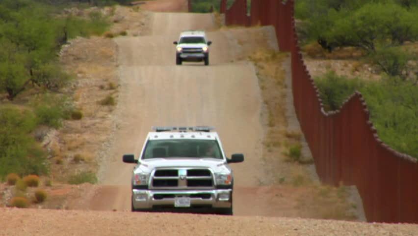 ARIZONA, USA-CIRCA 2012-Border patrol vehicles move along the U.S. Mexico border.