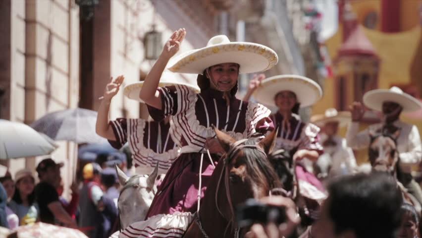 GUANAJUATO, MEXICO - 28 SEPTEMBER 2013: Women in a Traditional Escaramuza Charra, the feminine practice in mexican rodeos during parade DESFILE DE GUANAJUATO 2013