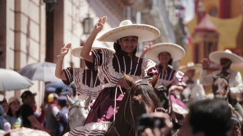 GUANAJUATO, MEXICO - 28 SEPTEMBER 2013: Women in a Traditional Escaramuza Charra, the feminine practice in mexican rodeos during parade DESFILE DE GUANAJUATO 2013