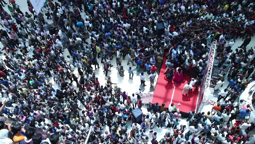 Crowded shopping at mall in India. crazy crowd running behind a celebrity. Unusual. Commuters aerial view.Group of Indian people / shoppers walking / rushing top view