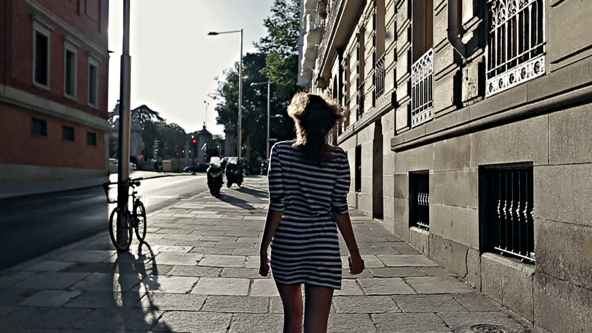 Young girl walks through the streets of Madrid