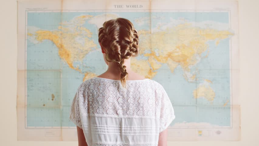 Tourist woman looking at world map planning travel adventure | Shutterstock HD Video #4908911