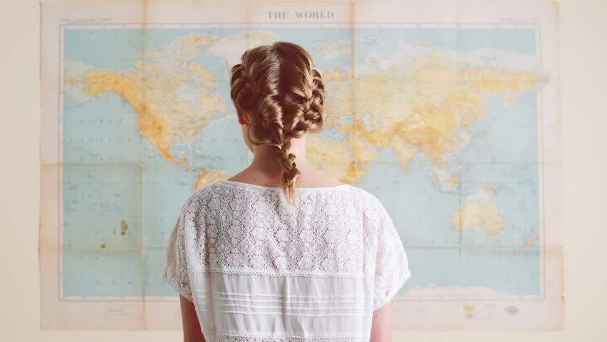Tourist woman looking at world map planning travel adventure   Shutterstock HD Video #4908911