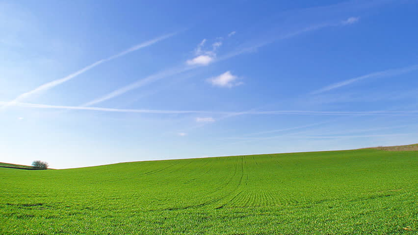 Time lapse, white clouds passing over green hills (windows xp background style !)