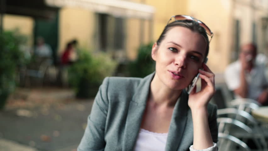 Businesswoman drinking coffee and talking on cellphone in cafe  | Shutterstock HD Video #4912514
