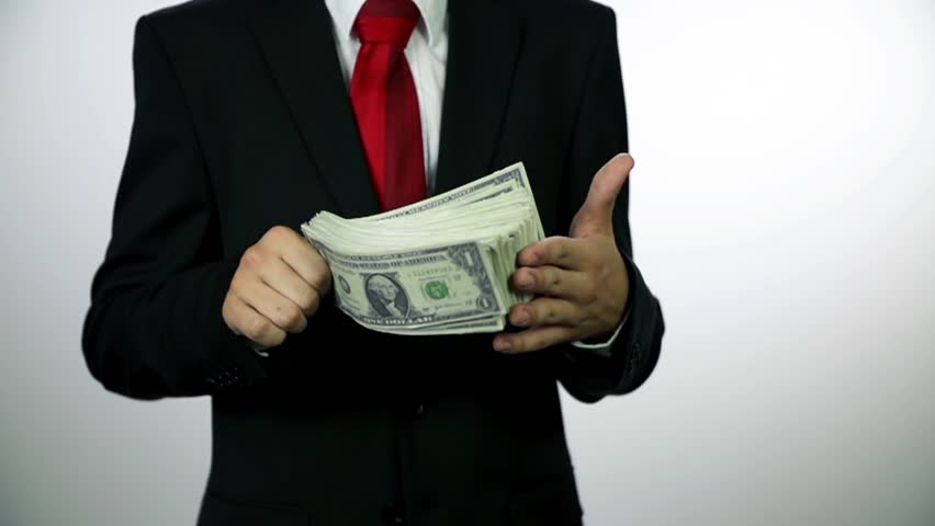 Business man with pack of money in slow motion. Slow motion money shots of young business man full of corrupted money, throwing it in the air and bribing. | Shutterstock HD Video #4919321