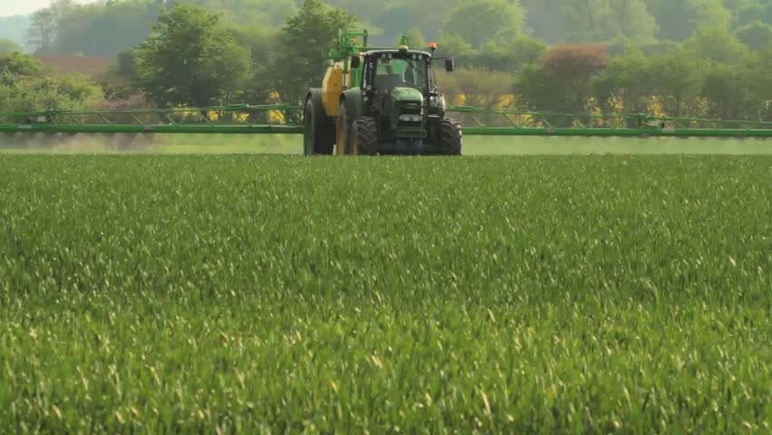 Spreading Pesticides on a Corn Field