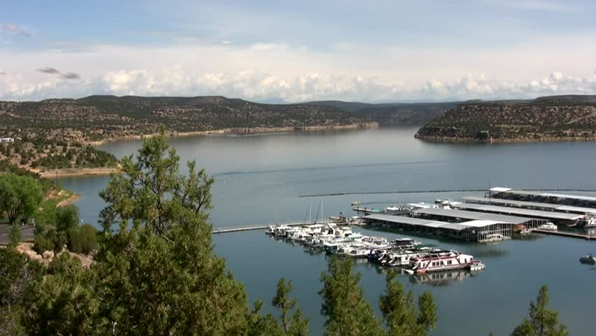 HD slow pan left to right across Navajo Lake and the marina on a bright summer day in northern New Mexico