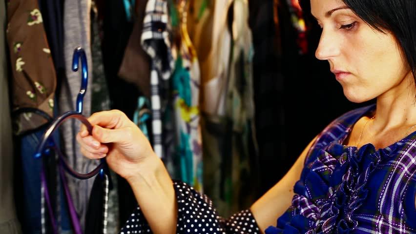Women arranges clothes on closet   Shutterstock HD Video #4973069