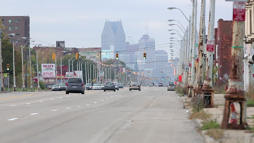 Detroit viewed from a distance down a busy city street. Could be used for industry, traffic, Detroit Michigan, skyline, sky scrapper, uptown, downtown, or urban setting.  Transportation or commuter.