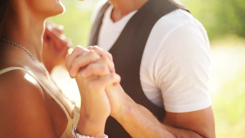 Romantic couple in field with lens flare | Shutterstock HD Video #4979339